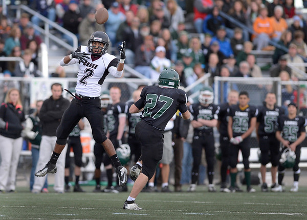 Silver Creek High School's Angel Sanchez (No. 2) nearly intercepts a pass intended for Conifer High School's Matthew McClintock (No. 27) during the third quarter, Saturday, Nov. 24, 2012, at Trailblazer Stadium in Lakewood.<br /> (Matthew Jonas/Times-Call)
