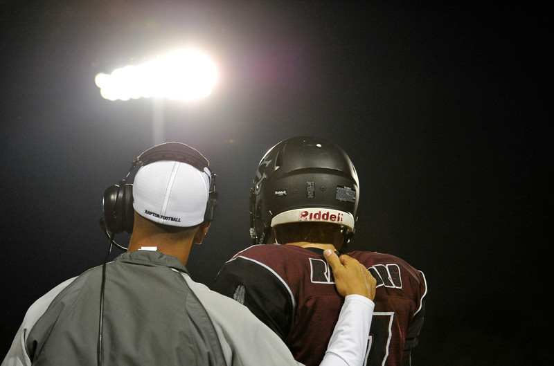 Silver Creek High School's quarterback Ben Sjobakken (No. 7) talks to a coach between plays in the game against Holy Family High School during the second quarter, Friday, Sept. 21, 2012, at Everly-Montgomery Field in Longmont.<br /> (Matthew Jonas/Times-Call)