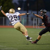 Holy Family High School's Chanson Segeth (No. 25) can't make the completing while followed by Silver Creek High School's Anthony Emberley (No. 24) during the first quarter, Friday, Sept. 21, 2012, at Everly-Montgomery Field in Longmont.<br /> (Matthew Jonas/Times-Call)