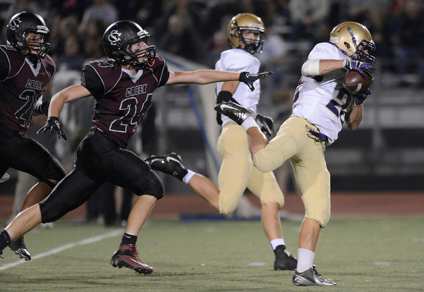 Holy Family High School's Jason Martinez (No. 23) is just out of reach from Silver Creek High School's Anthony Emberley (No. 24) during the second quarter, Friday, Sept. 21, 2012, at Everly-Montgomery Field in Longmont.<br /> (Matthew Jonas/Times-Call)