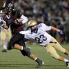 Silver Creek High School's Trey Fleming (No. 21) dodges Holy Family High School's Jason Martinez (No. 23) during the second quarter, Friday, Sept. 21, 2012, at Everly-Montgomery Field in Longmont.<br /> (Matthew Jonas/Times-Call)