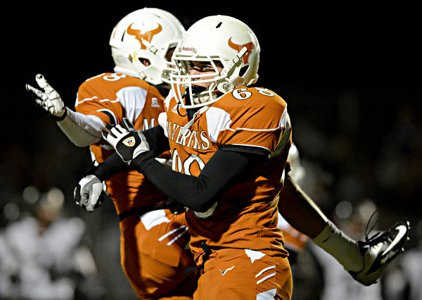 """Mead's Braden Ruddy (68) and Alex Mead celebrate after recovering a fumble during the game at Mead High School on Friday, Oct. 26, 2012.  For more photos and a video visit  <a href=""""http://www.BoCoPreps.com"""">http://www.BoCoPreps.com</a>.<br /> (Greg Lindstrom/Times-Call)"""