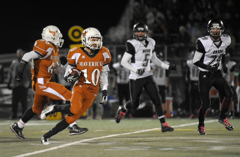 "Aaron Cheung (10)  of Mead, runs the ball during the game Friday, Oct. 26, 2012, at Mead High School.  Silver Creek beat Mead 35-6.  For more photos visit  <a href=""http://www.BoCoPreps.com"">http://www.BoCoPreps.com</a>.<br /> (Elaine Cromie/For the Times-Call)"