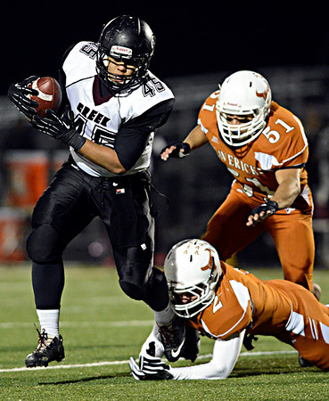 "Silver Creek's Kyle Kent (45) runs past Mead's Kyle Couch (2) and Gabe Alvarado (51) during the game at Mead High School on Friday, Oct. 26, 2012.  For more photos and a video visit  <a href=""http://www.BoCoPreps.com"">http://www.BoCoPreps.com</a>.<br /> (Greg Lindstrom/Times-Call)"