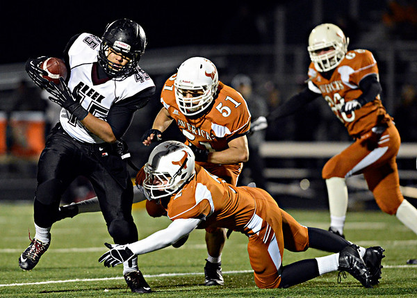 """Silver Creek's Kyle Kent (45) runs past Mead's Kyle Couch (2) and Gabe Alvarado (51) during the game at Mead High School on Friday, Oct. 26, 2012.  For more photos and a video visit  <a href=""""http://www.BoCoPreps.com"""">http://www.BoCoPreps.com</a>.<br /> (Greg Lindstrom/Times-Call)"""