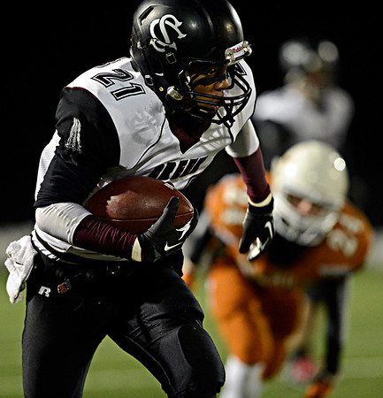 "Silver Creek's Trey Fleming (21) runs for extra yards past Mead's Thomas Jenkins (24) during the game at Mead High School on Friday, Oct. 26, 2012.  For more photos and a video visit  <a href=""http://www.BoCoPreps.com"">http://www.BoCoPreps.com</a>.<br /> (Greg Lindstrom/Times-Call)"
