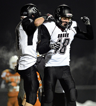 """Silver Creek's Eric Machmuller (18) and Zane Lindsey celebrate after Lindsey's touchdown during the game at Mead High School on Friday, Oct. 26, 2012.  Silver Creek beat Mead 35-6.  For more photos visit  <a href=""""http://www.BoCoPreps.com"""">http://www.BoCoPreps.com</a>.<br /> (Greg Lindstrom/Times-Call)"""