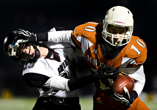 """Mead's Aaron Cheung (10) stiff-arms Silver Creek's Ross Fitzgerald (29) during the game at Mead High School on Friday, Oct. 26, 2012.  Silver Creek beat Mead 35-6.  For more photos visit  <a href=""""http://www.BoCoPreps.com"""">http://www.BoCoPreps.com</a>.<br /> (Greg Lindstrom/Times-Call)"""