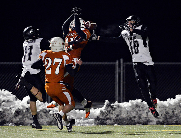 """A pass bounces off Mead's Tyler Tiano (11) and into the hands of Silver Creek's Eric Machmuller (18) during the game at Mead High School on Friday, Oct. 26, 2012.  Silver Creek beat Mead 35-6.  For more photos visit  <a href=""""http://www.BoCoPreps.com"""">http://www.BoCoPreps.com</a>.<br /> (Greg Lindstrom/Times-Call)"""