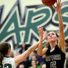 "Silver Creek's Emilie Rembert (5) shoots over D'Evelyn's Laura Tyree during the game at D'Evelyn High School on Saturday, March 2, 2013. Silver Creek lost to D'Evelyn 70-51. For more photos visit  <a href=""http://www.BoCoPreps.com"">http://www.BoCoPreps.com</a>.<br /> (Greg Lindstrom/Times-Call)"