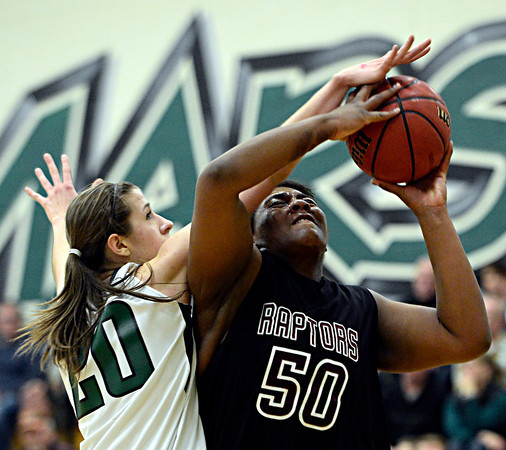 "Silver Creek's Grace Reed (50) goes up for a shot against D'Evelyn's Mallory Seemann (20) during the game at D'Evelyn High School on Saturday, March 2, 2013. Silver Creek lost to D'Evelyn 70-51. For more photos visit  <a href=""http://www.BoCoPreps.com"">http://www.BoCoPreps.com</a>.<br /> (Greg Lindstrom/Times-Call)"