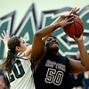 """Silver Creek's Grace Reed (50) goes up for a shot against D'Evelyn's Mallory Seemann (20) during the game at D'Evelyn High School on Saturday, March 2, 2013. Silver Creek lost to D'Evelyn 70-51. For more photos visit  <a href=""""http://www.BoCoPreps.com"""">http://www.BoCoPreps.com</a>.<br /> (Greg Lindstrom/Times-Call)"""