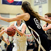 """Silver Creek defenders, left to right, Tess Warner, Emilie Rembert and Julie Dauer swarm D'Evelyn's Morgan Ducklow during the game at D'Evelyn High School on Saturday, March 2, 2013. Silver Creek lost to D'Evelyn 70-51. For more photos visit  <a href=""""http://www.BoCoPreps.com"""">http://www.BoCoPreps.com</a>.<br /> (Greg Lindstrom/Times-Call)"""