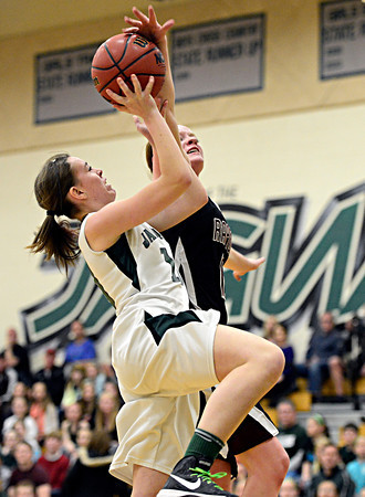 "Silver Creek's Julie Dauer blocks a shot by D'Evelyn's Katie Cunniff during the game at D'Evelyn High School on Saturday, March 2, 2013. Silver Creek lost to D'Evelyn 70-51. For more photos visit  <a href=""http://www.BoCoPreps.com"">http://www.BoCoPreps.com</a>.<br /> (Greg Lindstrom/Times-Call)"