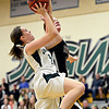 """Silver Creek's Julie Dauer blocks a shot by D'Evelyn's Katie Cunniff during the game at D'Evelyn High School on Saturday, March 2, 2013. Silver Creek lost to D'Evelyn 70-51. For more photos visit  <a href=""""http://www.BoCoPreps.com"""">http://www.BoCoPreps.com</a>.<br /> (Greg Lindstrom/Times-Call)"""