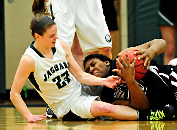"""Silver Creek's Grace Reed grabs a loose ball ahead of D'Evelyn's Laura Tyree (23) during the game at D'Evelyn High School on Saturday, March 2, 2013. Silver Creek lost to D'Evelyn 70-51. For more photos visit  <a href=""""http://www.BoCoPreps.com"""">http://www.BoCoPreps.com</a>.<br /> (Greg Lindstrom/Times-Call)"""