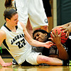 "Silver Creek's Grace Reed grabs a loose ball ahead of D'Evelyn's Laura Tyree (23) during the game at D'Evelyn High School on Saturday, March 2, 2013. Silver Creek lost to D'Evelyn 70-51. For more photos visit  <a href=""http://www.BoCoPreps.com"">http://www.BoCoPreps.com</a>.<br /> (Greg Lindstrom/Times-Call)"