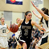 """Silver Creek's Margaret Davis (3) tries to drive past D'Evelyn's Laura Tyree during the game at D'Evelyn High School on Saturday, March 2, 2013. Silver Creek lost to D'Evelyn 70-51. For more photos visit  <a href=""""http://www.BoCoPreps.com"""">http://www.BoCoPreps.com</a>.<br /> (Greg Lindstrom/Times-Call)"""