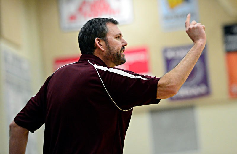 "Silver Creek head coach Dan Kloster calls out instructions during the game at D'Evelyn High School on Saturday, March 2, 2013. Silver Creek lost to D'Evelyn 70-51. For more photos visit  <a href=""http://www.BoCoPreps.com"">http://www.BoCoPreps.com</a>.<br /> (Greg Lindstrom/Times-Call)"