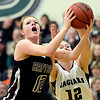 "Silver Creek's Julie Dauer, left, competes for a rebound against D'Evelyn's Emily Lusk during the game at D'Evelyn High School on Saturday, March 2, 2013. Silver Creek lost to D'Evelyn 70-51. For more photos visit  <a href=""http://www.BoCoPreps.com"">http://www.BoCoPreps.com</a>.<br /> (Greg Lindstrom/Times-Call)"