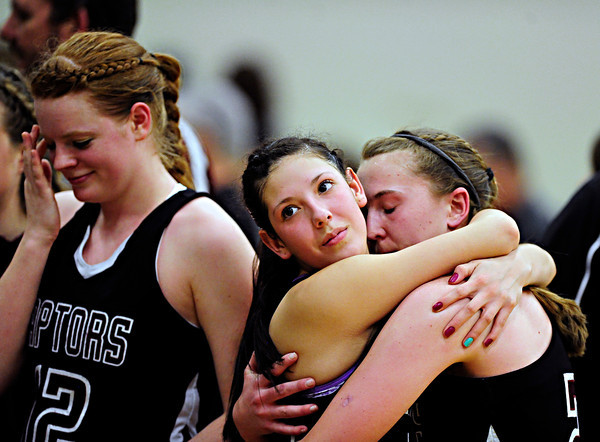 """Silver Creek's Julie Dauer, left, Carrie Ramirez, center, and Shelby Keil react after the game at D'Evelyn High School on Saturday, March 2, 2013. Silver Creek lost to D'Evelyn 70-51. For more photos visit  <a href=""""http://www.BoCoPreps.com"""">http://www.BoCoPreps.com</a>.<br /> (Greg Lindstrom/Times-Call)"""