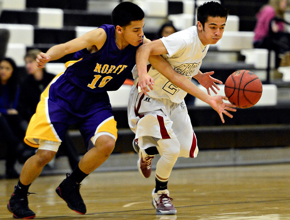"Silver Creek's Chico Grine (24) has the ball stolen by Denver North's Ibashi Vandevelde (10) during the game at Silver Creek High School on Friday, Dec. 21, 2012. Silver Creek beat Denver North 61-39. For more photos from the game visit  <a href=""http://www.BoCoPreps.com"">http://www.BoCoPreps.com</a> <br /> (Greg Lindstrom/Times-Call)"