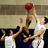 "Silver Creek's Luke Goforth (32) blocks a shot by Denver North's Cesar Escobedo (3) during the game at Silver Creek High School on Friday, Dec. 21, 2012. Silver Creek beat Denver North 61-39. For more photos from the game visit  <a href=""http://www.BoCoPreps.com"">http://www.BoCoPreps.com</a> <br /> (Greg Lindstrom/Times-Call)"