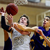 "Silver Creek's Brock Johnson (23) is fouled by Denver North's Isaiah Martin (44) during the game at Silver Creek High School on Friday, Dec. 21, 2012. Silver Creek beat Denver North 61-39. For more photos from the game visit  <a href=""http://www.BoCoPreps.com"">http://www.BoCoPreps.com</a> <br /> (Greg Lindstrom/Times-Call)"