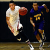 "Silver Creek's Trey Fleming (12) breaks away from Denver North's Adonis Glover (24) during the game at Silver Creek High School on Friday, Dec. 21, 2012. Silver Creek beat Denver North 61-39. For more photos from the game visit  <a href=""http://www.BoCoPreps.com"">http://www.BoCoPreps.com</a> <br /> (Greg Lindstrom/Times-Call)"
