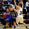 "Longmont's Kathryn Schell (23) drives past Silver Creek's Margaret Davis (3) during the game at Silver Creek High School on Tuesday, Jan. 29, 2013. Silver Creek beat Longmont 62-45. For more photos visit  <a href=""http://www.BoCoPreps.com"">http://www.BoCoPreps.com</a>.<br /> (Greg Lindstrom/Times-Call)"
