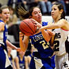 """Longmont's Anna Schell is pressured by Silver Creek's Carrie Ramirez during the game at Silver Creek High School on Tuesday, Jan. 29, 2013. Silver Creek beat Longmont 62-45. For more photos visit  <a href=""""http://www.BoCoPreps.com"""">http://www.BoCoPreps.com</a>.<br /> (Greg Lindstrom/Times-Call)"""