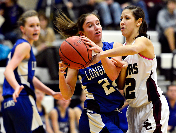 "Longmont's Anna Schell is pressured by Silver Creek's Carrie Ramirez during the game at Silver Creek High School on Tuesday, Jan. 29, 2013. Silver Creek beat Longmont 62-45. For more photos visit  <a href=""http://www.BoCoPreps.com"">http://www.BoCoPreps.com</a>.<br /> (Greg Lindstrom/Times-Call)"