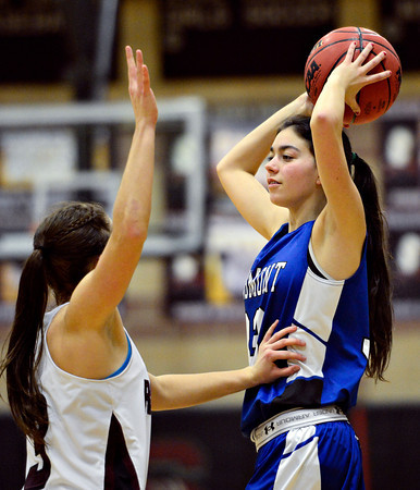 "Longmont's Lydia Pane, right, looks for an open teammate as she is defended by Silver Creek's Margaret Davis during the game at Silver Creek High School on Tuesday, Jan. 29, 2013. Silver Creek beat Longmont 62-45. For more photos visit  <a href=""http://www.BoCoPreps.com"">http://www.BoCoPreps.com</a>.<br /> (Greg Lindstrom/Times-Call)"