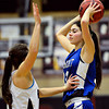 """Longmont's Lydia Pane, right, looks for an open teammate as she is defended by Silver Creek's Margaret Davis during the game at Silver Creek High School on Tuesday, Jan. 29, 2013. Silver Creek beat Longmont 62-45. For more photos visit  <a href=""""http://www.BoCoPreps.com"""">http://www.BoCoPreps.com</a>.<br /> (Greg Lindstrom/Times-Call)"""