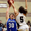 "Silver Creek's Emilie Rembert (5) blocks a shot by Longmont's Sarah McKee (30) during the game at Silver Creek High School on Tuesday, Jan. 29, 2013. Rembert was called for a foul on the play. Silver Creek beat Longmont 62-45. For more photos visit  <a href=""http://www.BoCoPreps.com"">http://www.BoCoPreps.com</a>.<br /> (Greg Lindstrom/Times-Call)"