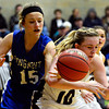 """Longmont's Sydney Wetterstrom (15) and Silver Creek's Julia Bishop (10) compete for a loose ball during the game at Silver Creek High School on Tuesday, Jan. 29, 2013. Silver Creek beat Longmont 62-45. For more photos visit  <a href=""""http://www.BoCoPreps.com"""">http://www.BoCoPreps.com</a>.<br /> (Greg Lindstrom/Times-Call)"""