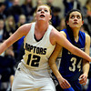 """Silver Creek's Julie Dauer (12) boxes out Longmont's Dailyn Johnson (34) during the game at Silver Creek High School on Tuesday, Jan. 29, 2013. Silver Creek beat Longmont 62-45. For more photos visit  <a href=""""http://www.BoCoPreps.com"""">http://www.BoCoPreps.com</a>.<br /> (Greg Lindstrom/Times-Call)"""