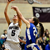"""Silver Creek's Emilie Rembert (5) shoots over Longmont's Kathryn Schell (23) during the game at Silver Creek High School on Tuesday, Jan. 29, 2013. Silver Creek beat Longmont 62-45. For more photos visit  <a href=""""http://www.BoCoPreps.com"""">http://www.BoCoPreps.com</a>.<br /> (Greg Lindstrom/Times-Call)"""