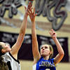 "Longmont's Gabriella Fallon (3) shoots over Silver Creek's Teagan Knechtel (51) during the game at Silver Creek High School on Tuesday, Jan. 29, 2013. Silver Creek beat Longmont 62-45. For more photos visit  <a href=""http://www.BoCoPreps.com"">http://www.BoCoPreps.com</a>.<br /> (Greg Lindstrom/Times-Call)"