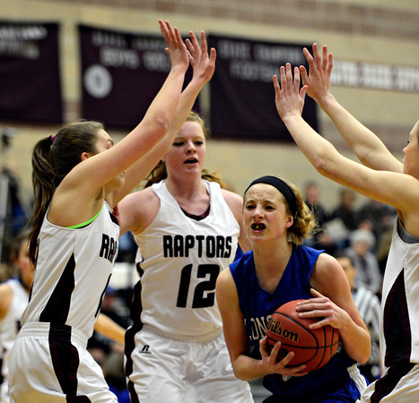 "Longmont's Sydney Wetterstrom, center, is pressured by Silver Creek defenders during the game at Silver Creek High School on Tuesday, Jan. 29, 2013. Silver Creek beat Longmont 62-45. For more photos visit  <a href=""http://www.BoCoPreps.com"">http://www.BoCoPreps.com</a>.<br /> (Greg Lindstrom/Times-Call)"