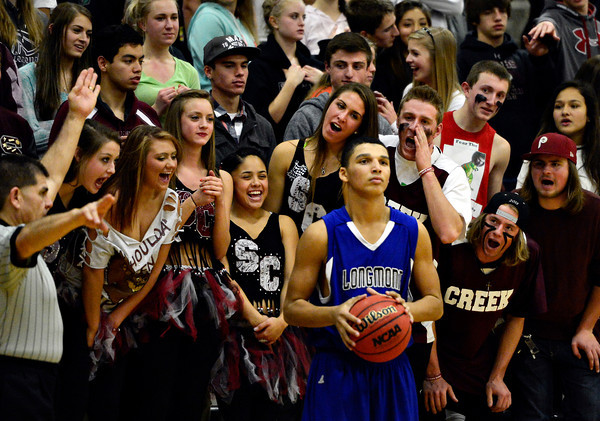 """Silver Creek fans heckle Longmont's Kevin Mitchell during the game at Silver Creek High School on Tuesday, Jan. 29, 2013. Longmont beat Silver Creek 65-34. For more photos visit  <a href=""""http://www.BoCoPreps.com"""">http://www.BoCoPreps.com</a>.<br /> (Greg Lindstrom/Times-Call)"""