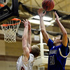 "Longmont's Austin Kemp (21) grabs a rebound over Silver Creek's Eric Machmuller during the game at Silver Creek High School on Tuesday, Jan. 29, 2013. Longmont beat Silver Creek 65-34. For more photos visit  <a href=""http://www.BoCoPreps.com"">http://www.BoCoPreps.com</a>.<br /> (Greg Lindstrom/Times-Call)"