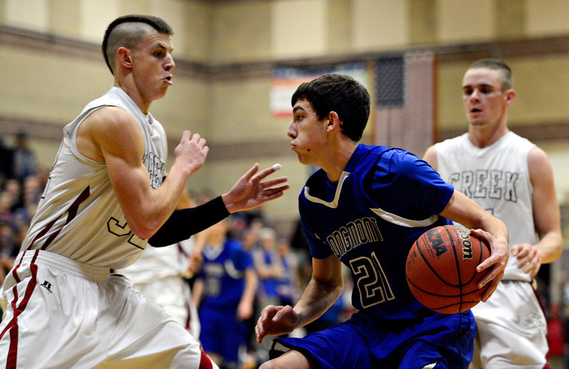 """Silver Creek's Luke Goforth, left, and Zane Lindsey defend Longmont's Austin Kemp (21) during the game at Silver Creek High School on Tuesday, Jan. 29, 2013. Longmont beat Silver Creek 65-34. For more photos visit  <a href=""""http://www.BoCoPreps.com"""">http://www.BoCoPreps.com</a>.<br /> (Greg Lindstrom/Times-Call)"""