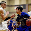 "Silver Creek's Luke Goforth, left, and Zane Lindsey defend Longmont's Austin Kemp (21) during the game at Silver Creek High School on Tuesday, Jan. 29, 2013. Longmont beat Silver Creek 65-34. For more photos visit  <a href=""http://www.BoCoPreps.com"">http://www.BoCoPreps.com</a>.<br /> (Greg Lindstrom/Times-Call)"