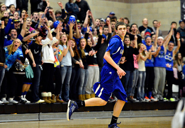 "Longmont fans cheer for Justinian Jessup during the game at Silver Creek High School on Tuesday, Jan. 29, 2013. Longmont beat Silver Creek 65-34. For more photos visit  <a href=""http://www.BoCoPreps.com"">http://www.BoCoPreps.com</a>.<br /> (Greg Lindstrom/Times-Call)"