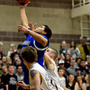 "Longmont's Marcus Johnson pulls down a rebound over Silver Creek players during the game at Silver Creek High School on Tuesday, Jan. 29, 2013. Longmont beat Silver Creek 65-34. For more photos visit  <a href=""http://www.BoCoPreps.com"">http://www.BoCoPreps.com</a>.<br /> (Greg Lindstrom/Times-Call)"