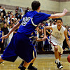 """Silver Creek's Jordan Wright (35) drives past Longmont defenders during the game at Silver Creek High School on Tuesday, Jan. 29, 2013. Longmont beat Silver Creek 65-34. For more photos visit  <a href=""""http://www.BoCoPreps.com"""">http://www.BoCoPreps.com</a>.<br /> (Greg Lindstrom/Times-Call)"""