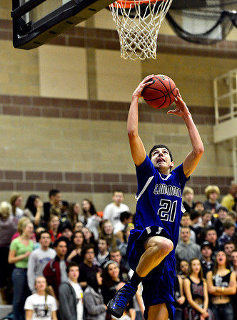 "Longmont's Austin Kemp (21) goes up to attempt a dunk during the game at Silver Creek High School on Tuesday, Jan. 29, 2013. Kemp missed the dunk. Longmont beat Silver Creek 65-34. For more photos visit  <a href=""http://www.BoCoPreps.com"">http://www.BoCoPreps.com</a>.<br /> (Greg Lindstrom/Times-Call)"