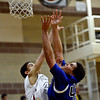"Longmont's Marcus Johnson, right, shoots over Silver Creek's Tyrone White during the game at Silver Creek High School on Tuesday, Jan. 29, 2013. Longmont beat Silver Creek 65-34. For more photos visit  <a href=""http://www.BoCoPreps.com"">http://www.BoCoPreps.com</a>.<br /> (Greg Lindstrom/Times-Call)"