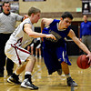 "Longmont's Eli Sullivan (23) is pressured by Silver Creek's Eric Machmuller during the game at Silver Creek High School on Tuesday, Jan. 29, 2013. Longmont beat Silver Creek 65-34. For more photos visit  <a href=""http://www.BoCoPreps.com"">http://www.BoCoPreps.com</a>.<br /> (Greg Lindstrom/Times-Call)"